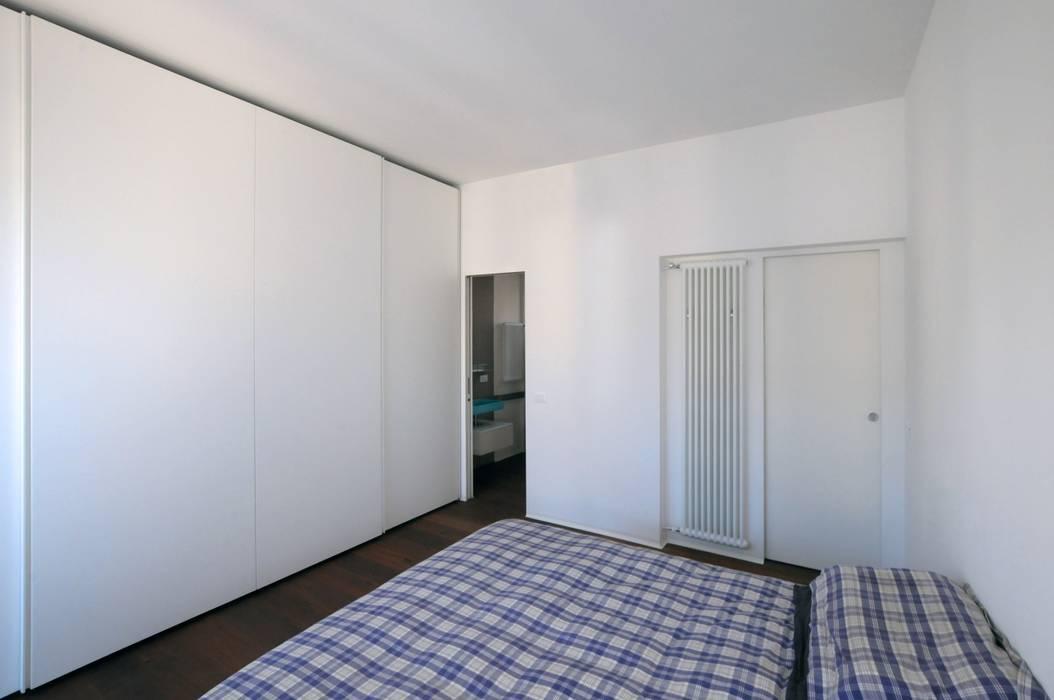 CASA ALL'EUR [2013]: Camera da letto in stile in stile Moderno di na3 - studio di architettura