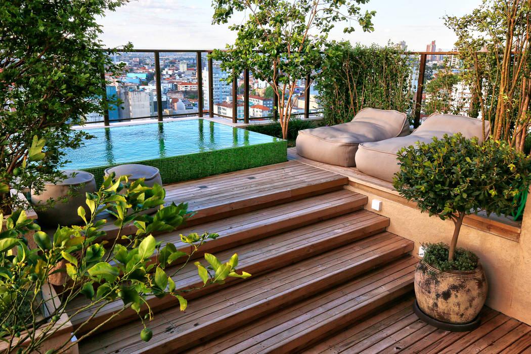 Balcones y terrazas modernos de Tellini Vontobel Arquitetura Moderno