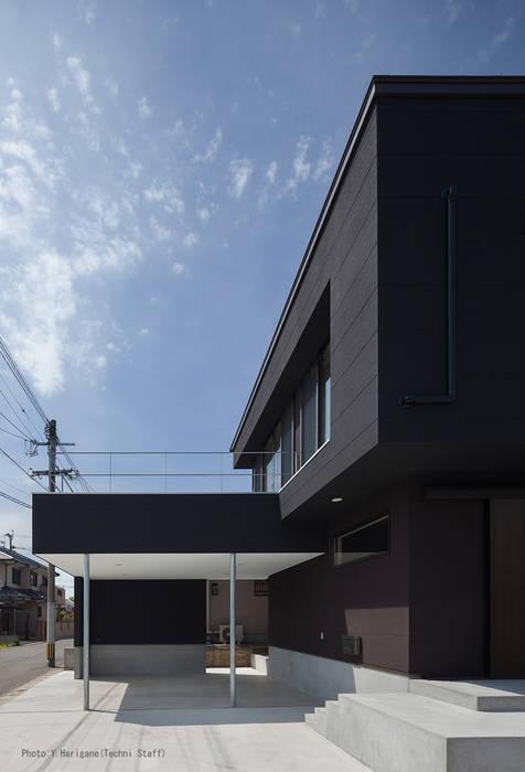 Casas de estilo minimalista de 松岡健治一級建築士事務所 Minimalista