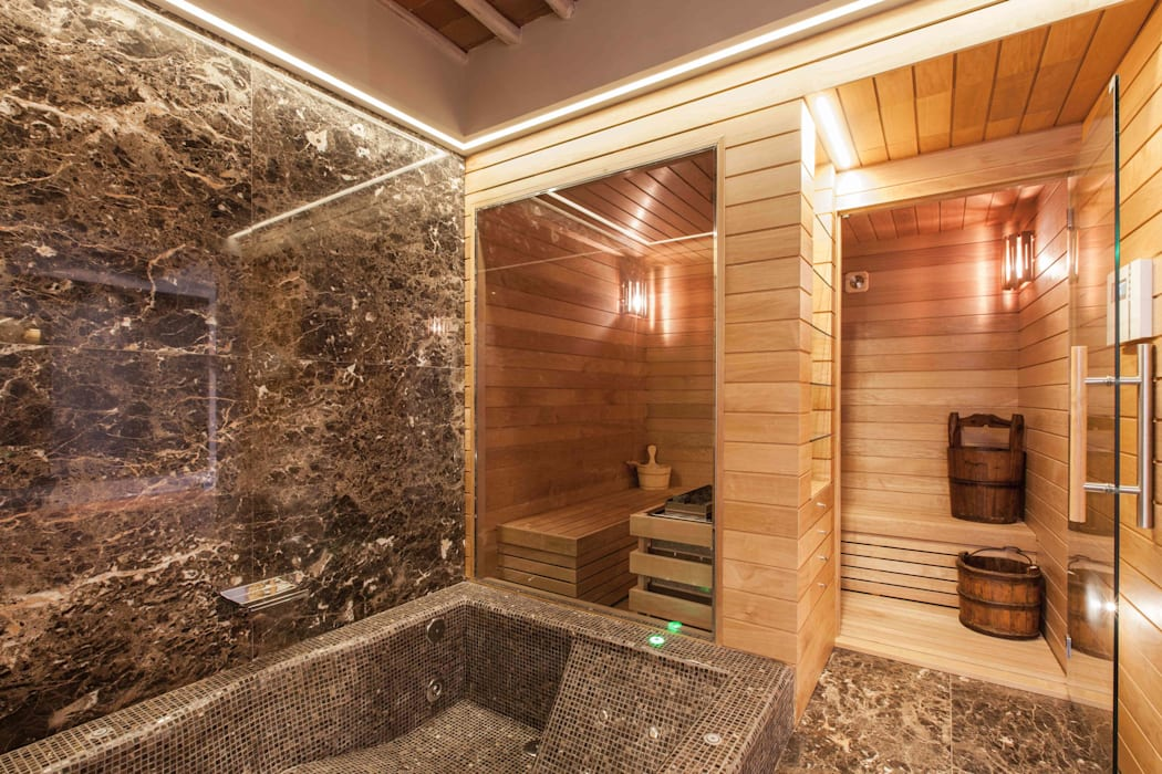 Sauna Finlandese in Hemlock: Spa in stile in stile Moderno di ki life  Wellness Operator