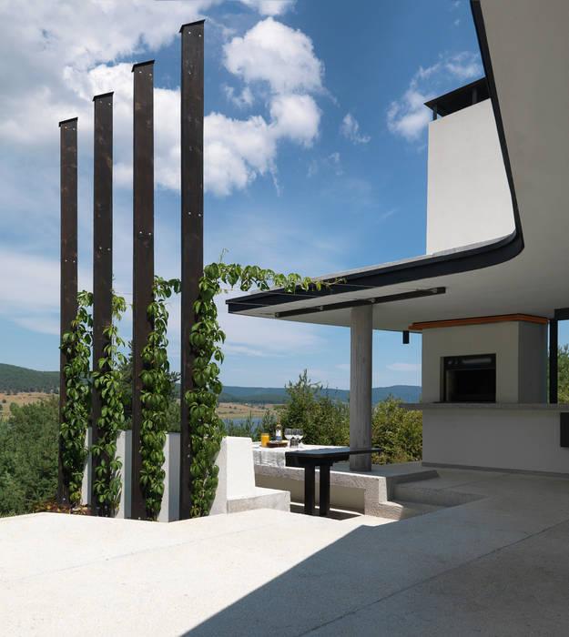 Fishing Lodge, Bulgaria:  Terrace by Simon Gill Architects