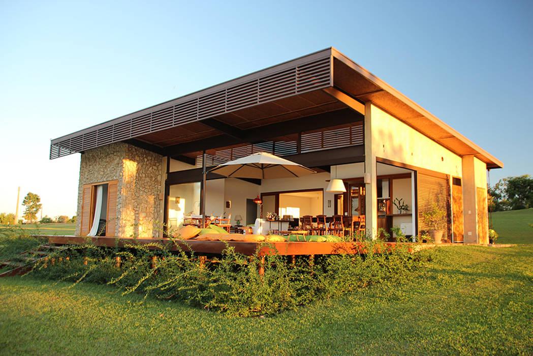 PROJETO CASA DA REPRESA: Casas  por Ambienta Arquitetura