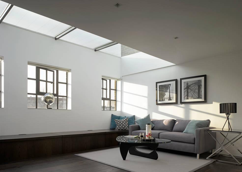 Brassworks:  Living room by Belsize Architects