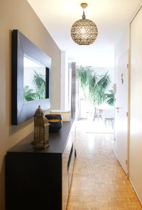 Une entrée dépaysante: Couloir et hall d'entrée de style  par Skéa Designer