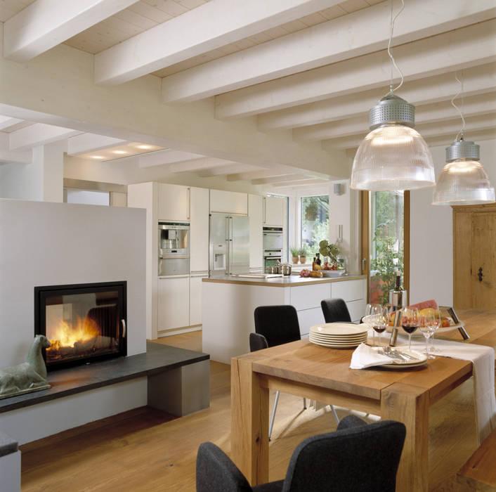 Salas de jantar modernas por Bau-Fritz GmbH & Co. KG Moderno