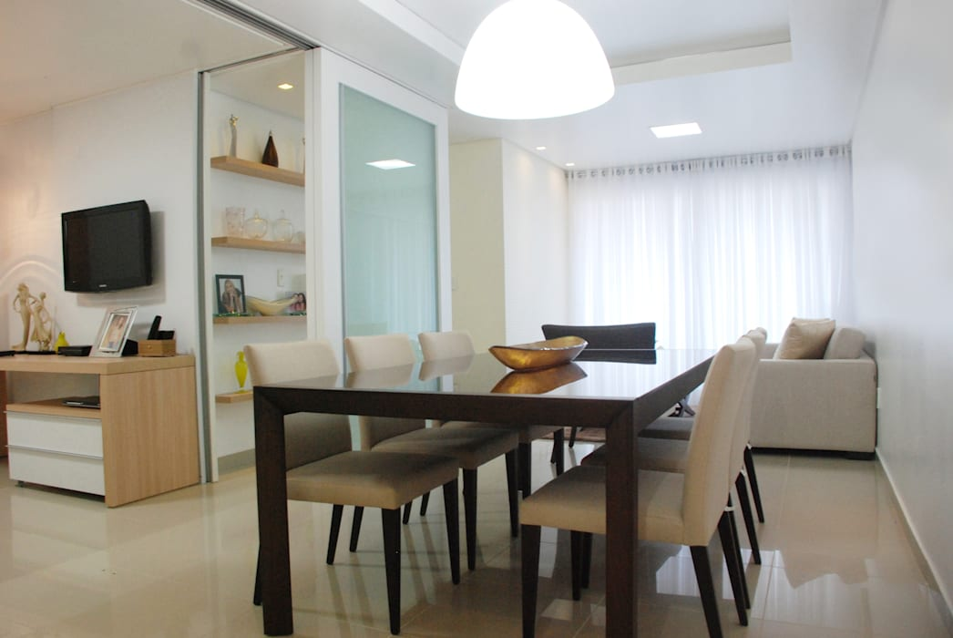 Dining room by Martins Lucena Arquitetos,