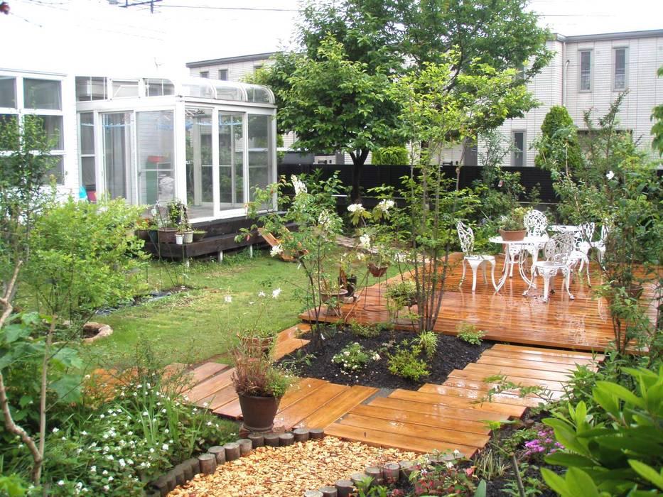 Eclectic style garden by jardinier Kirikui Eclectic
