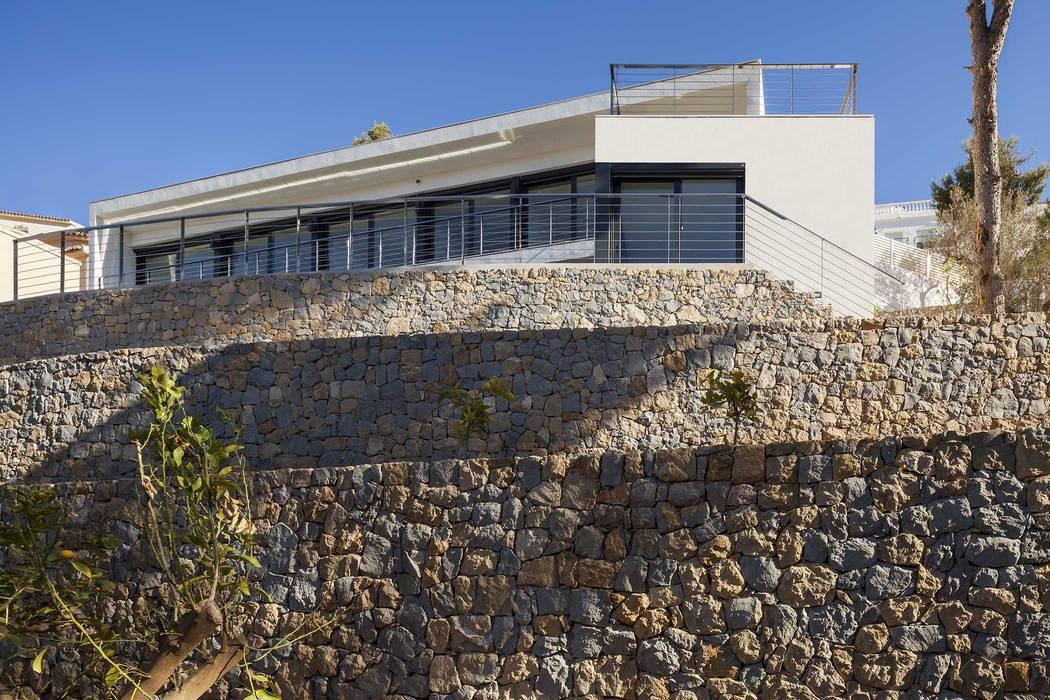 Casa Oos Casas de estilo mediterráneo de sanahuja&partners Mediterráneo