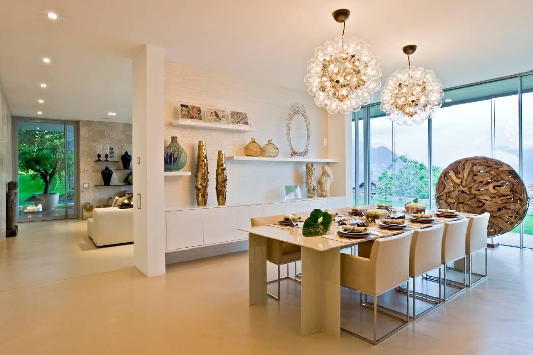 Oriental Chic: Salas de jantar  por Viterbo Interior design