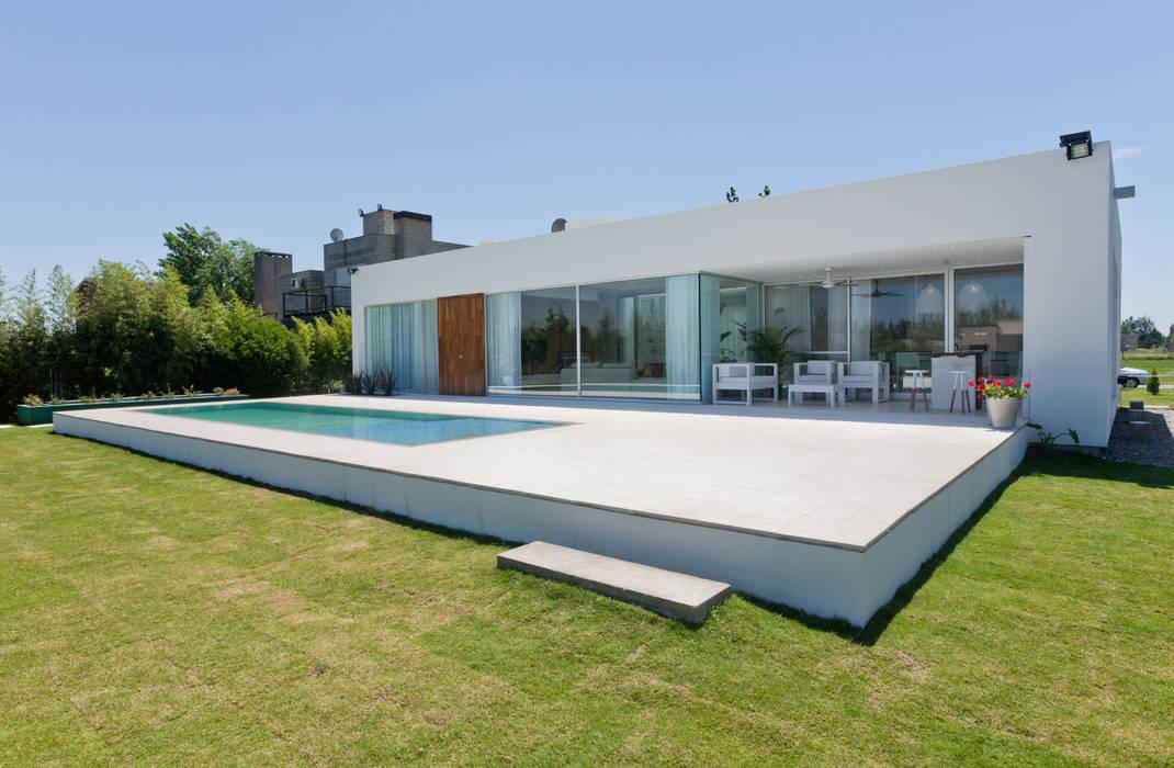 Casa C Puerto Roldan: Casas de estilo  por VISMARACORSI ARQUITECTOS,Moderno