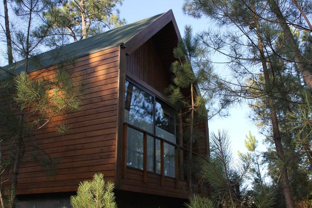3 anos depois... Casa em Cabeça Santa: Casas  por NORMA | Nova Arquitectura em Madeira (New Architecture in Wood)