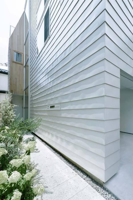 Modern houses by ディンプル建築設計事務所 Modern Stone