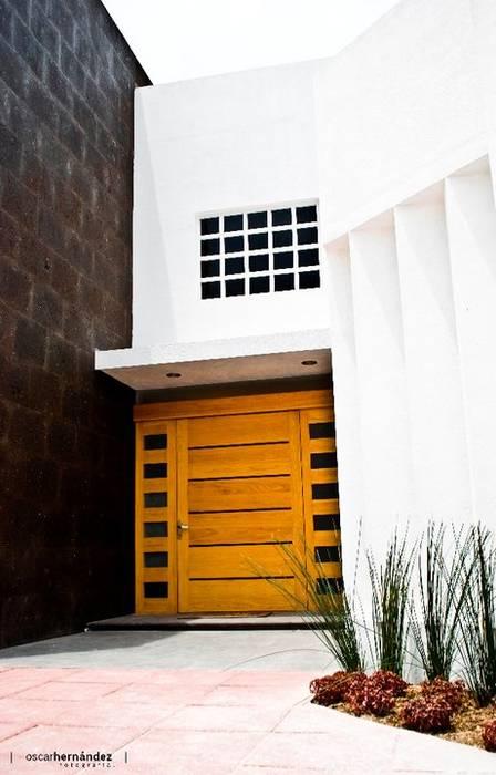 Casa Habitación - T.I: Casas de estilo  por MATE - ARQUITECTOS, Moderno Caliza