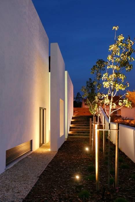 vista lateral Casas modernas por Visual Stimuli Moderno