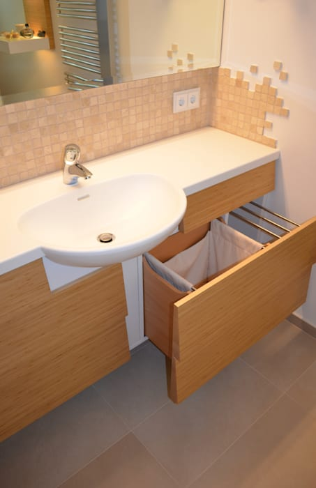 Waschtisch mit wäschekorb: badezimmer von wohnideen lebedies | homify