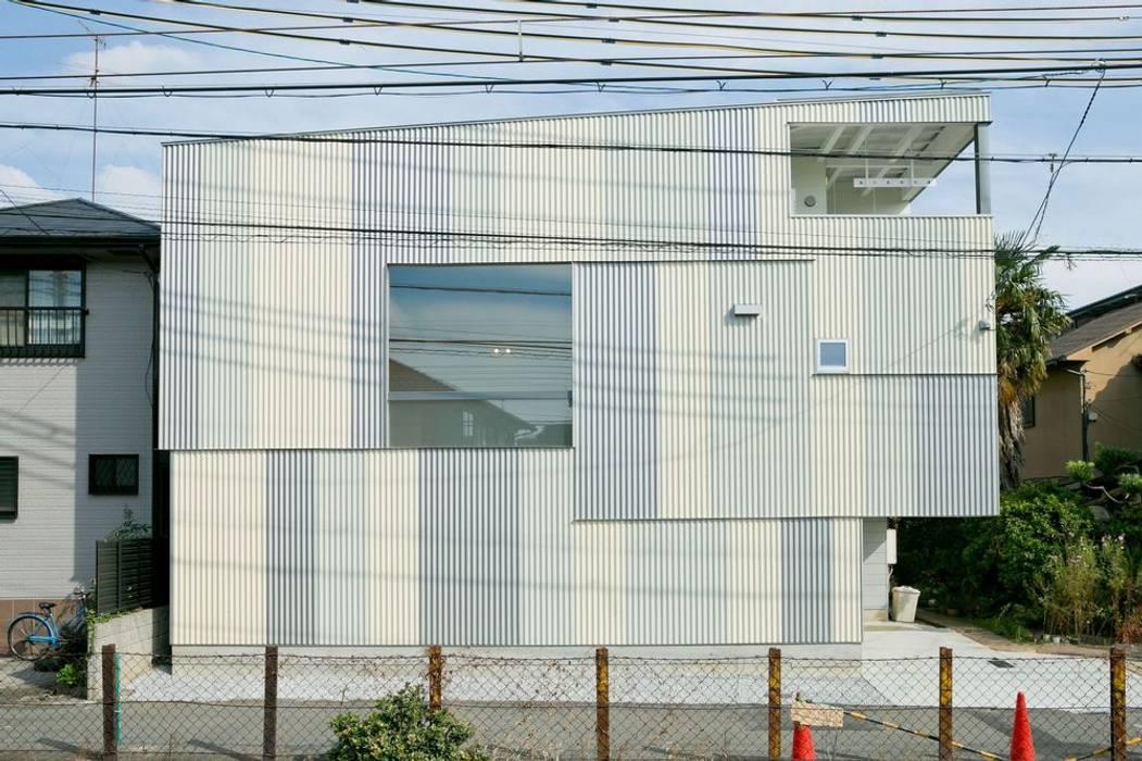 Casas de estilo ecléctico de ADS一級建築士事務所 Ecléctico