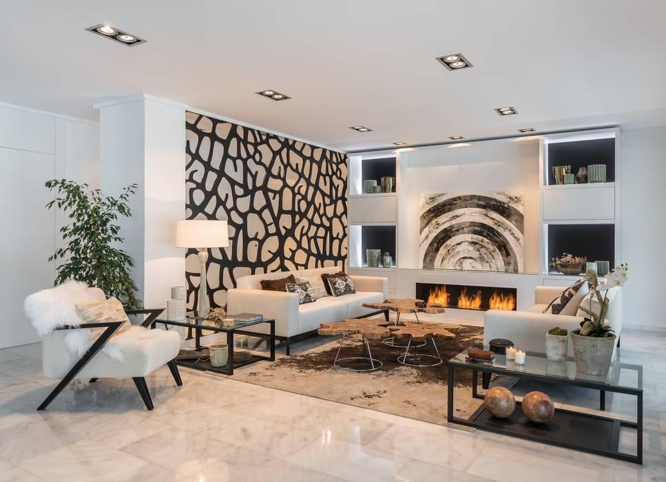 Salón simétrico: Salones de estilo  de Laura Yerpes Estudio de Interiorismo,