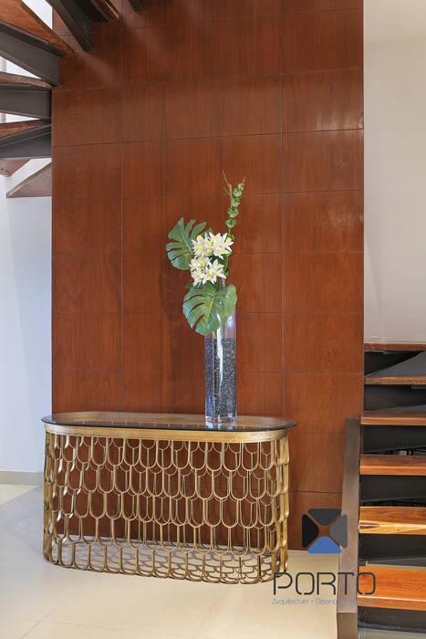 Pasillos, vestíbulos y escaleras de estilo ecléctico de PORTO Arquitectura + Diseño de Interiores Ecléctico