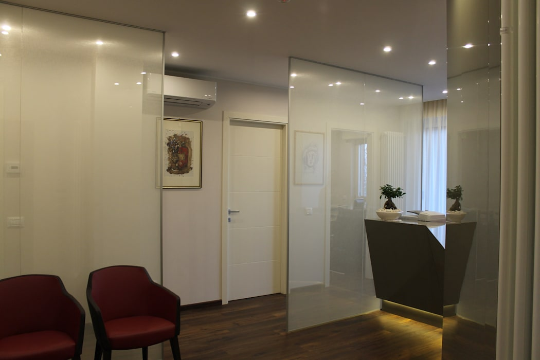 reception: Studio in stile in stile Eclettico di bilune studio