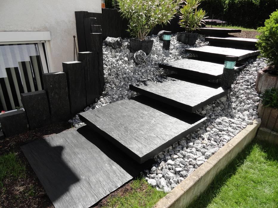 Garden by MM NATURSTEIN GMBH, Modern