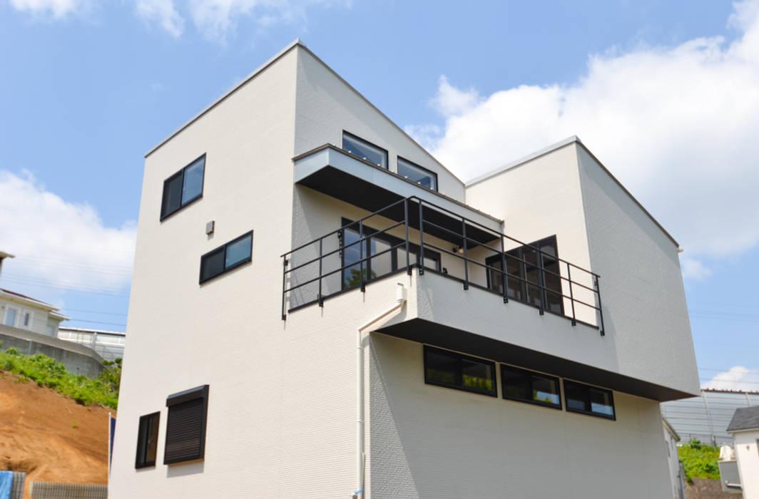 Casas estilo moderno: ideas, arquitectura e imágenes de 株式会社スタジオ・チッタ Studio Citta Moderno