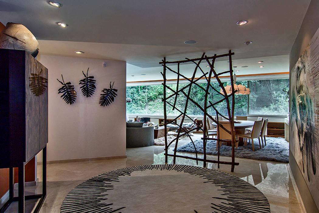 Salones de estilo moderno de Olivia Aldrete Haas Moderno