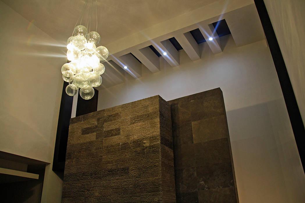 Volmen chimenea Salones modernos de Narda Davila arquitectura Moderno Mármol