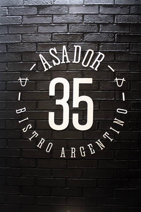 ASADOR 35 Gastronomía de estilo moderno de Narda Davila arquitectura Moderno Hierro/Acero