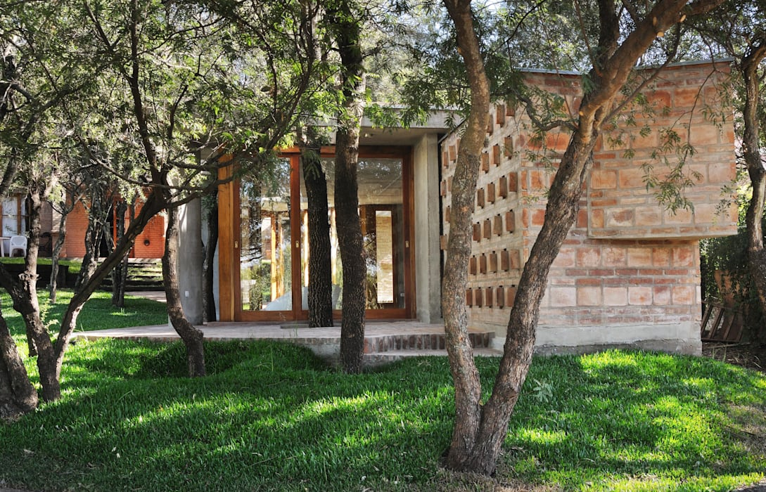 Casas de estilo  por Arq. Santiago Viale Lescano,