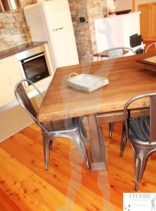 Zona pranzo: Sala da pranzo in stile in stile Rustico di Arredamenti Brigadoi