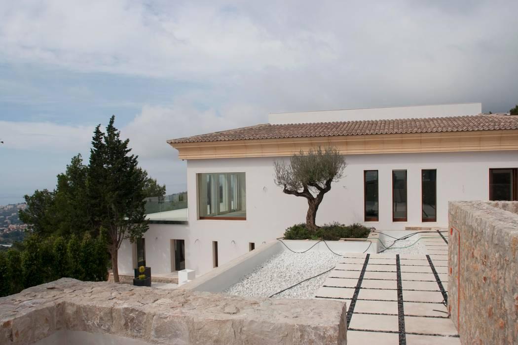VIVIENDA Casas de estilo mediterráneo de ABAD Y COTONER, S.L. Mediterráneo