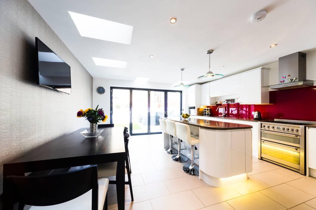 White Kitchen With Red Splashback Modern Pendants Bifold Doors Black Dining Table