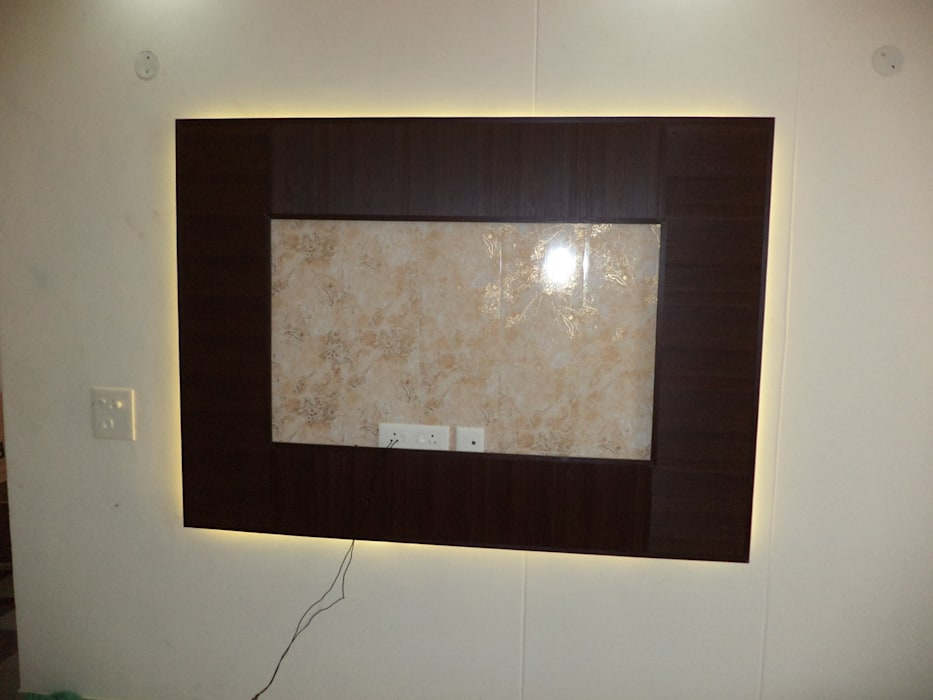 led tv panel:  Living room by Mohali Interiors