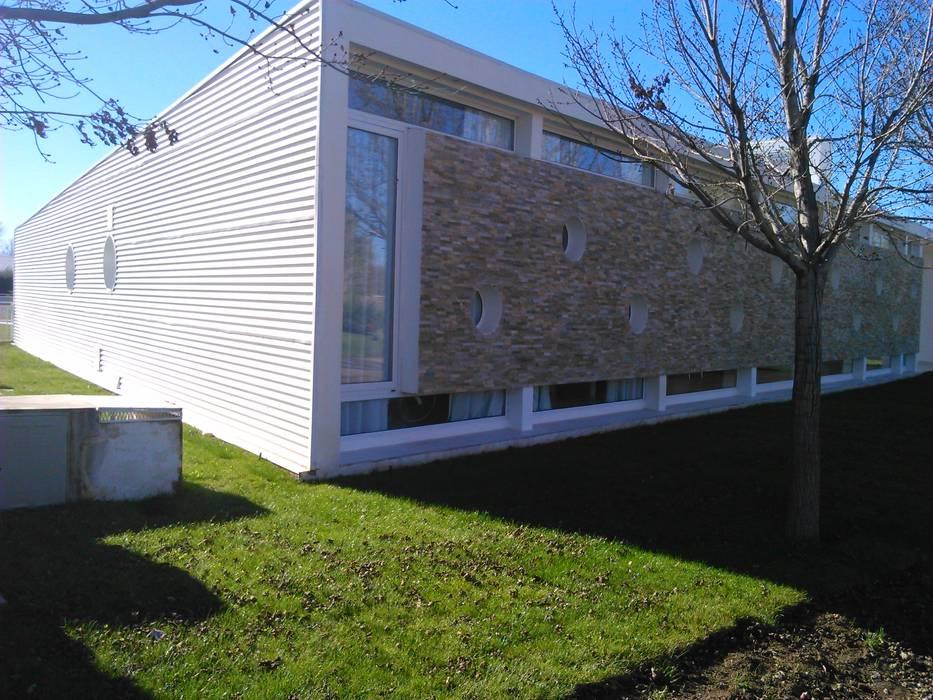 casa moderna casas de estilo por stremel construcciones