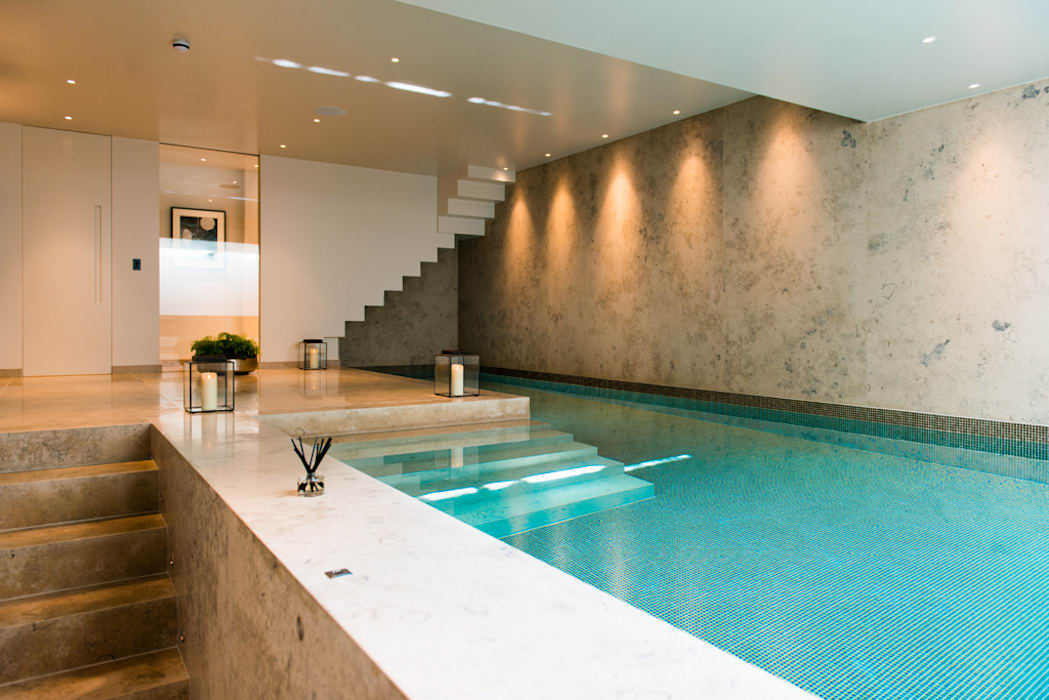 ​Basement pool at Bedford Gardens house. Nash Baker Architects Ltd Modern pool Stone White