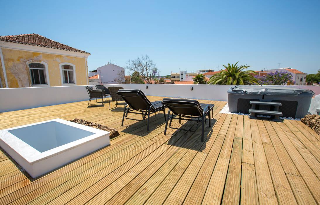 Casa do Largo Varandas, marquises e terraços modernos por homify Moderno Madeira Acabamento em madeira