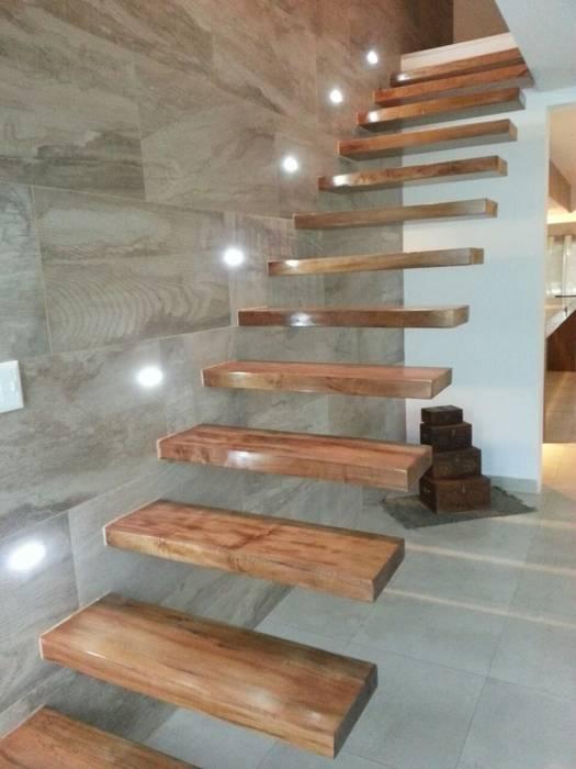 Escalera empotrada: Pasillos y recibidores de estilo  por Estudio A+I
