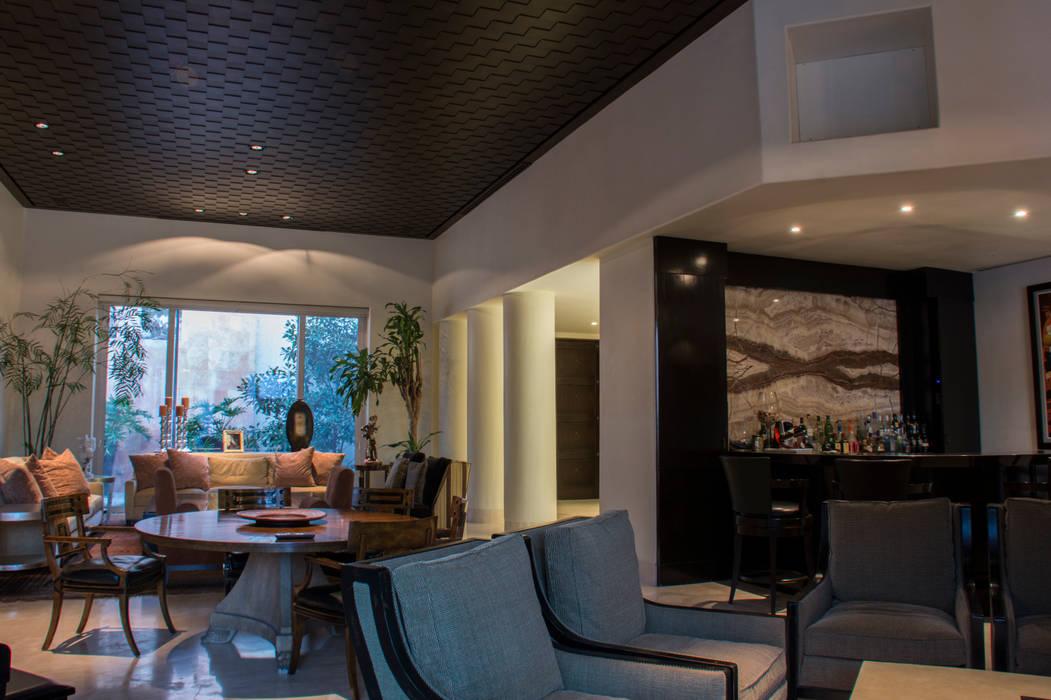 Salas / recibidores de estilo  por CH Proyectos