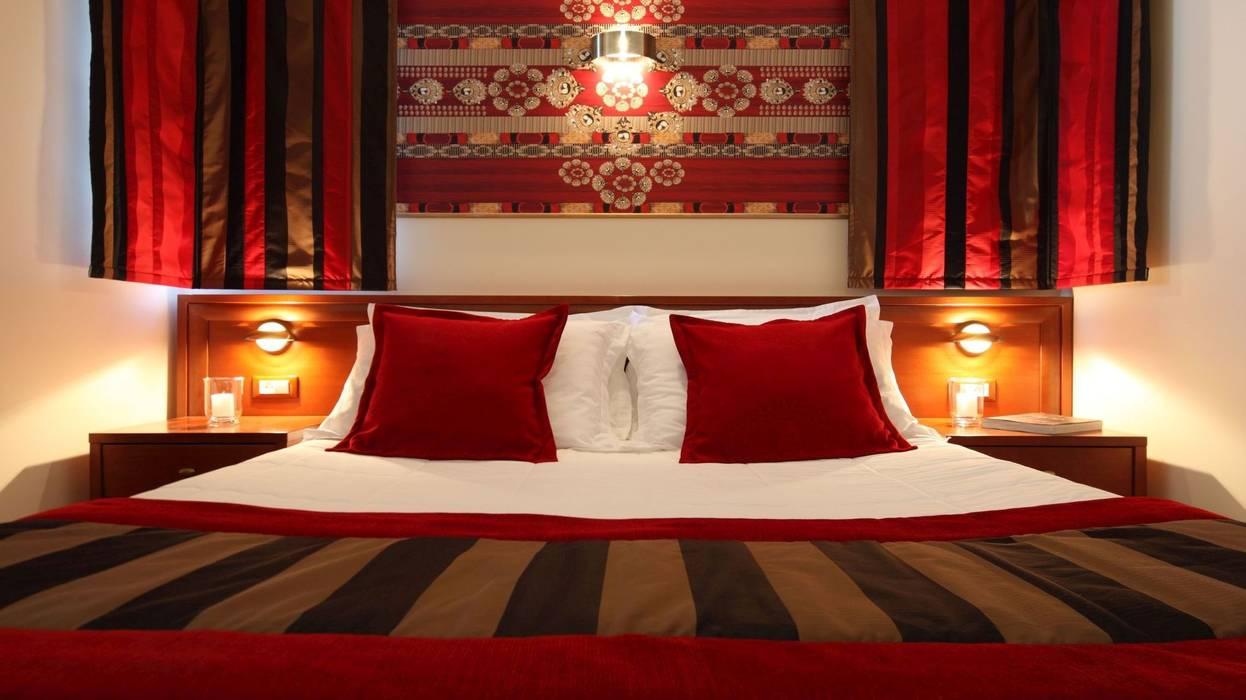 Chambre Supérieure N.10: Hôtels de style  par Sanabel Decor
