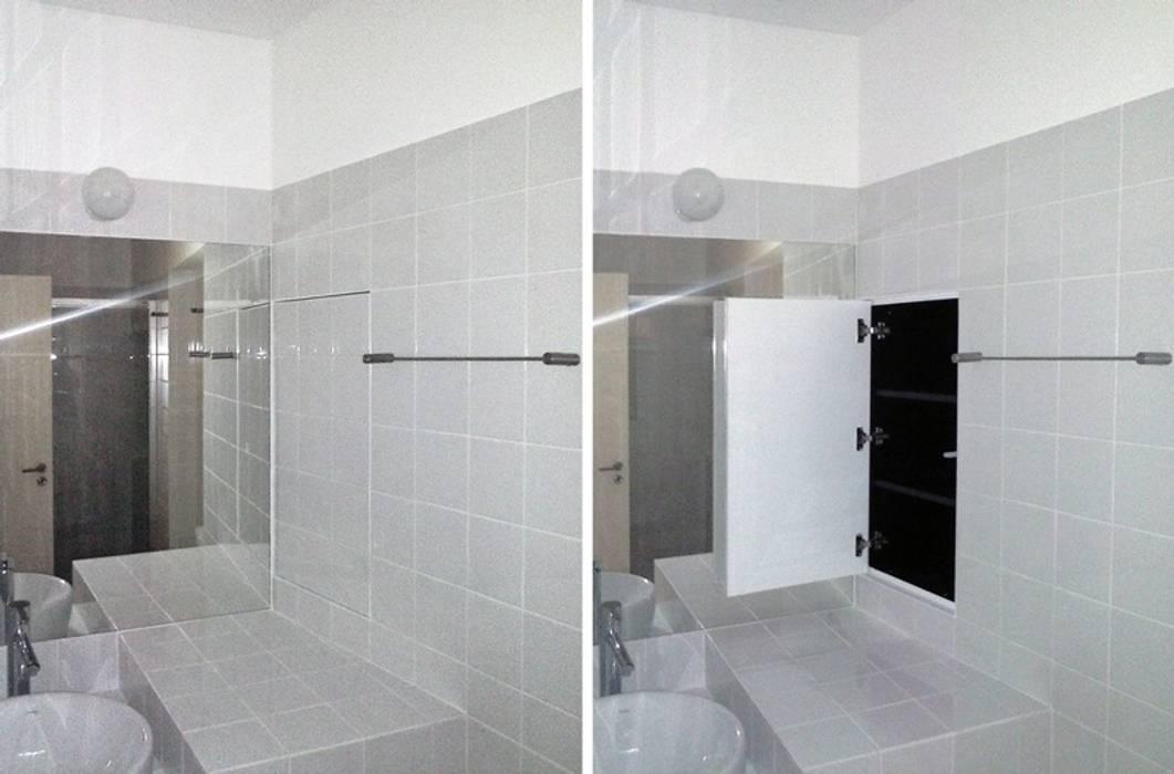 FOTOGRAFIAS: Casas de banho  por COLECTIVO arquitectos,