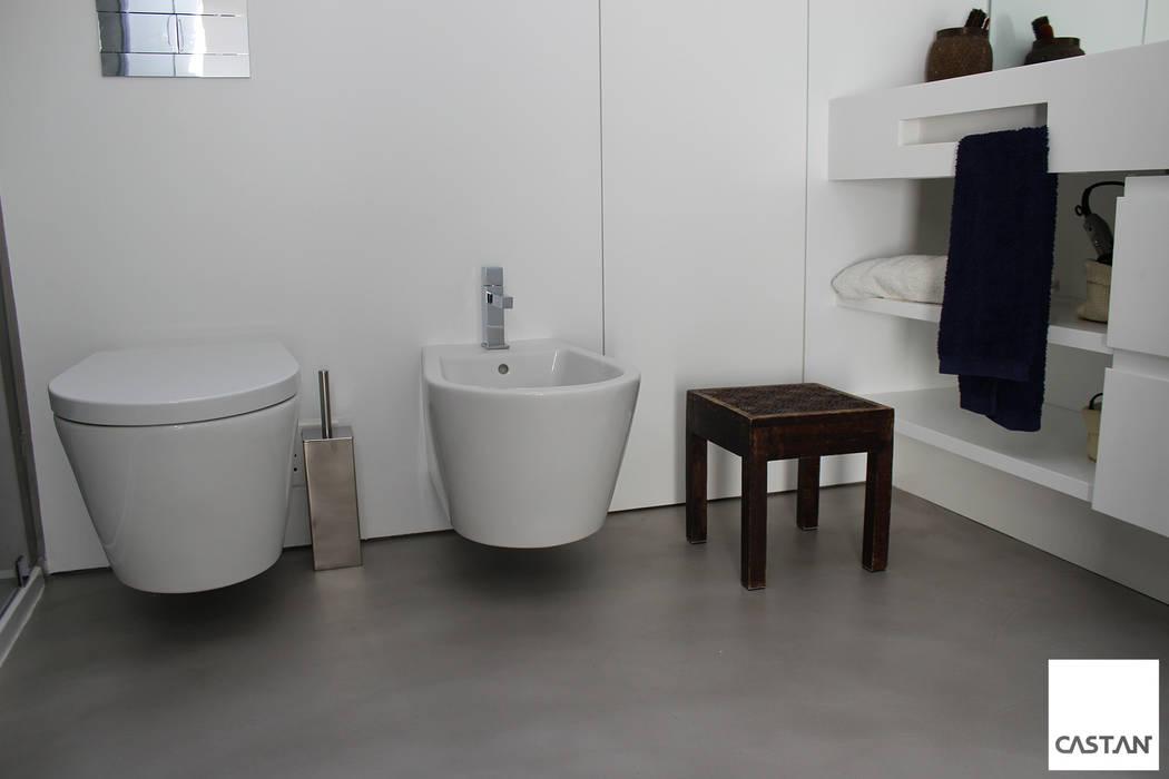 Instalação sanitária piso superior: Casas de banho  por Castan