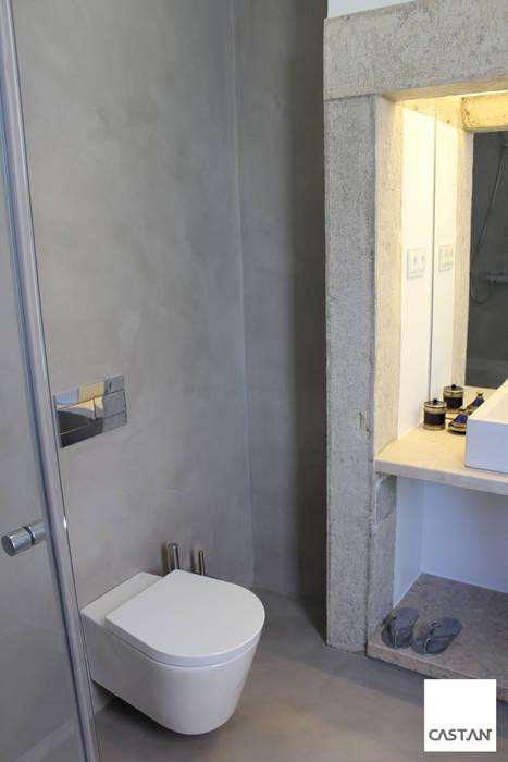Instalação sanitária piso inferior Casas de banho modernas por Castan Moderno