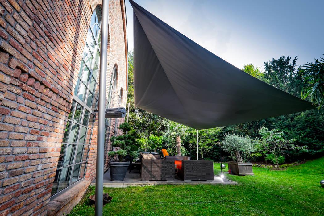 Sonnensegel in elektrisch aufrollbar - bad harzburg: garten von pina ...