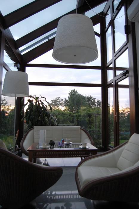 Colonial style conservatory by Pracownia Projektowa Architektury Krajobrazu Januszówka Colonial