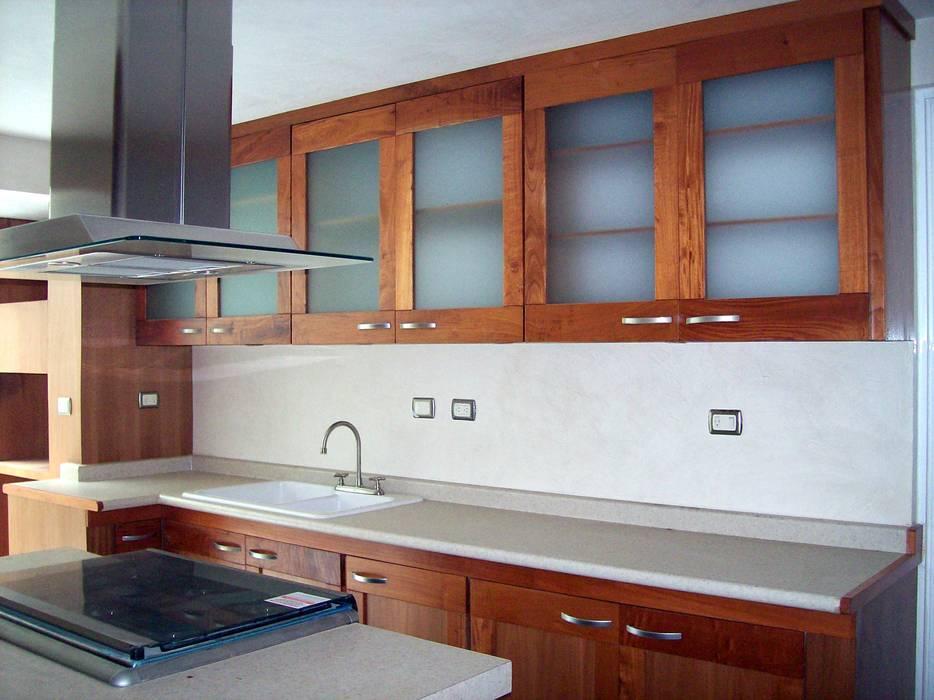 Modern kitchen by CouturierStudio Modern