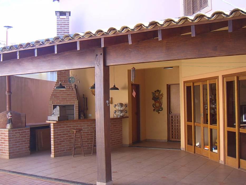 Parque Sabará I Terence Arquitetura Varandas, alpendres e terraços rústicos