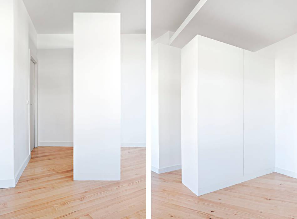 Estúdios São Victor - Reabilitação: Closets  por A2OFFICE,Eclético