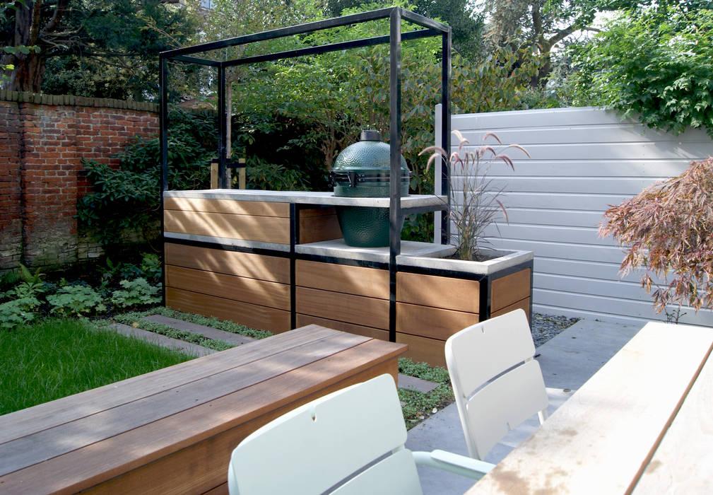 Familietuin met kookeiland Moderne tuinen van House of Green Modern