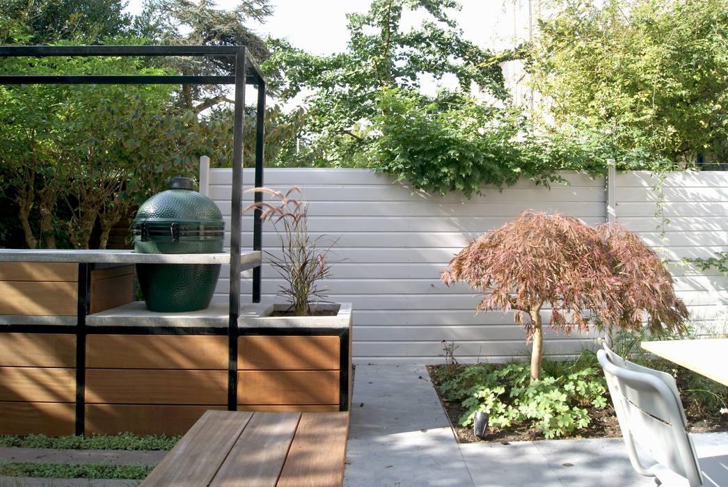 Familietuin met kookeiland House of Green Moderne tuinen