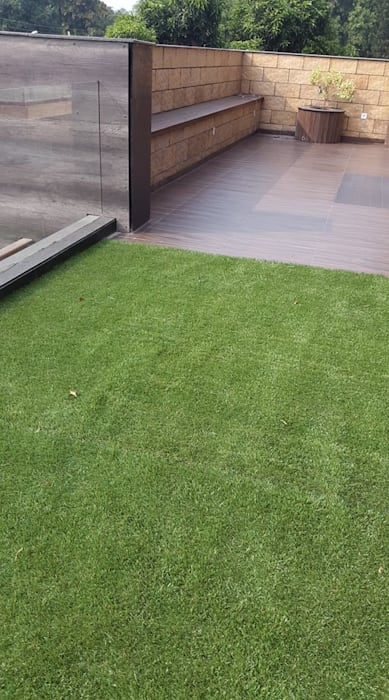 faux grass Classic style balcony, veranda & terrace by JRD Associates Classic Synthetic Brown